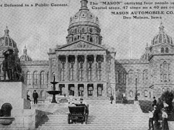 Black and white image of the front facade of the State of Iowa Capitol Building with three domes