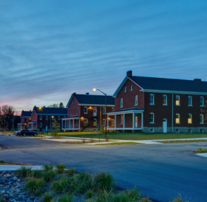 Wide view of Fort Des Moines buildings at twilight
